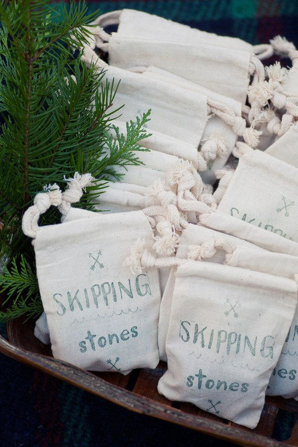 Gifts for Guests | Skipping stones for a lakeside wedding | Image via StyleMePretty.com