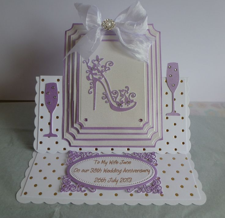 Easel card. I used grand large labels then added a tattered lace shoe. The stopper on the front is from radiant rectangles S5-161. The glasses have been cut out on the silhouette. Ribbon & embellishment from Chloe's