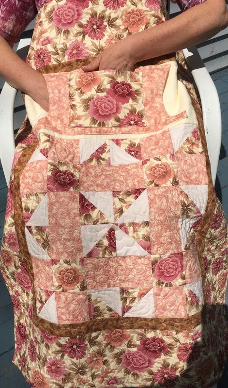 Mauve Rose Lovie Lap Quilt with Pockets from http://www.HomeSewnByCarolyn.com