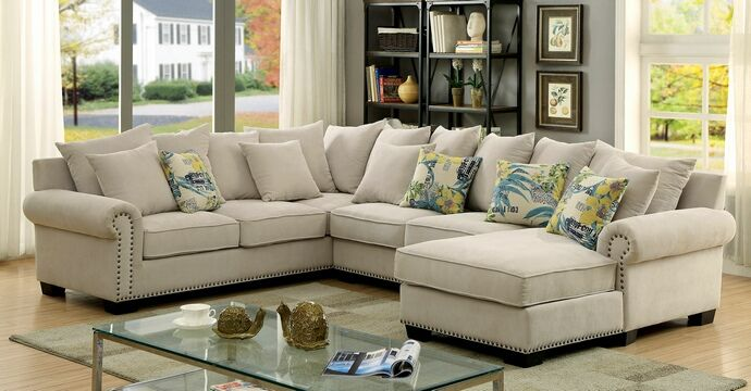 "3 pc Skyler collection ivory fabric upholstered transitional style sectional sofa with nail head trim accents. Sectional measures 125"" x 97"" x 65 1/2"" L chaise x 36 1/4"" D x 36 1/4"" H.  Some assembly may be required."