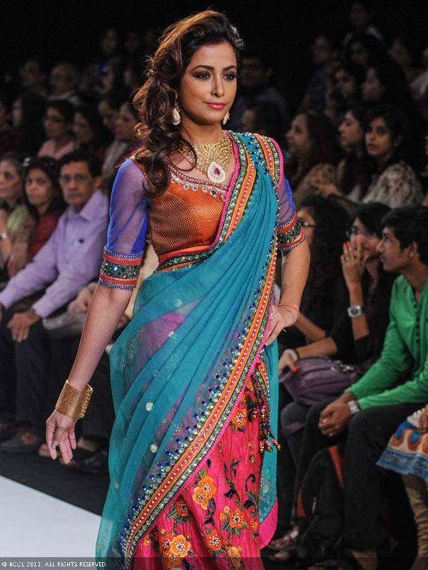 TV actress Madhura Naik walks the ramp to showcase a design by jewellery brand Prisha during the India International Jewellery Week (IIJW), held at Grand Hyatt, Mumbai, on August 07, 2013.