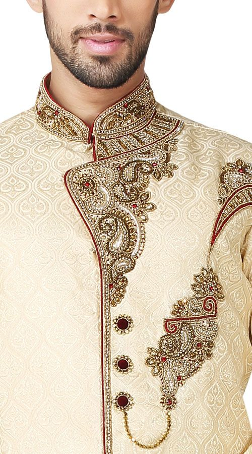 Off White Latest Designer Sherwani  Captivating cream color jacket with handcrafted stone work collar and front panel is making it sensible for party wear choices. Comes with maroon color trouser. Luxurious outfit is specially created for your personality  #Indiabazaar #Sherwani  #Indowestern #Handwork #Groomsherwani #Designer #Richlook #Jodhpuri