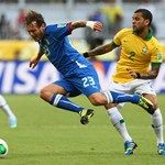Daniel Alves of Brazil  challenges Alessandro Diamanti of Italy