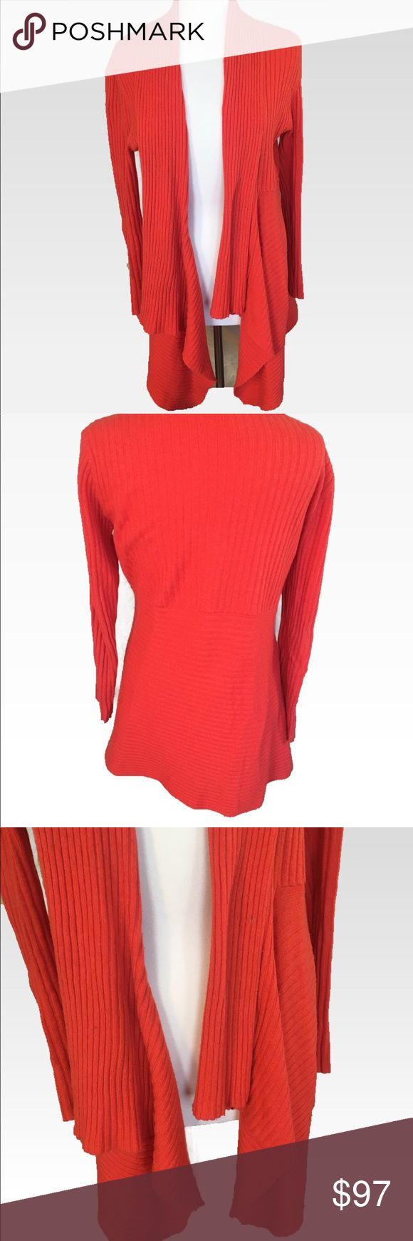 Luxurious Neiman Marcus Orange Cashmere CardiganXL Luxurious Neiman Marcus Orange Cashmere Cardigan! This is the Ferrari of cashmere. Unlike cheap knockoffs, the quality of this sweater is in the cashmere and the cut. This hangs perfectly, creating a flattering silhouette. And the color is so perfect for fall! Size XL. Paid $425 for this brand new. GUC. There is some pilling in various spots which is typical of pure cashmere. The price reflects. This is a steal! Grab it before it's gone…