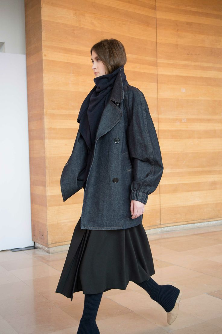 1. Caban in cotton denim / Asymetrical scarf in yak wool / Second-skin in merino wool / Wrapover skirt in cotton-viscose and wool gabardine / Gaiters in knitted yak wool / Boots in calf leather