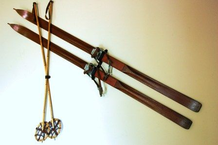 Vintage skis and poles hung on the wall in the sitting area
