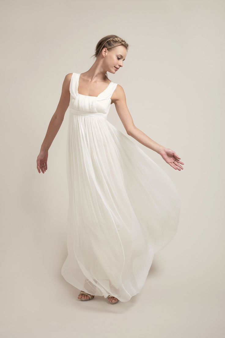 """HB6953 l With an intricately pleated square neckline and yards of carefully placed silk chiffon cascading from the empire waist, this wedding dress is perfect for an outdoor garden wedding. We fondly refer to this as the Jane Austen Dress. Its empire waistline can be lowered to a truer waist by using our 3"""" cream sash or any other decorative sashes. #sajawedding"""