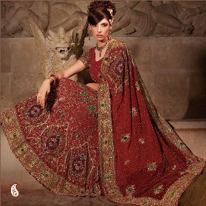 Lehenga with Rich hand work -- The fabulous designs adorning the garment are embellished with velvet , resham , sequins and zircon. It comes along with a lovely embroidered dupatta. A georgette lehenga choli.This richly crafted lehnga choli is sure to attract all attentions. $363