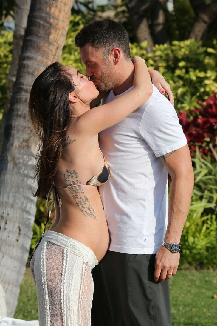 Pin for Later: Heat Up Your Summer With the Best Celebrity Kisses  Pregnant Megan Fox planted a passionate kiss on Brian Austin Green on an escape to Hawaii in June 2012.