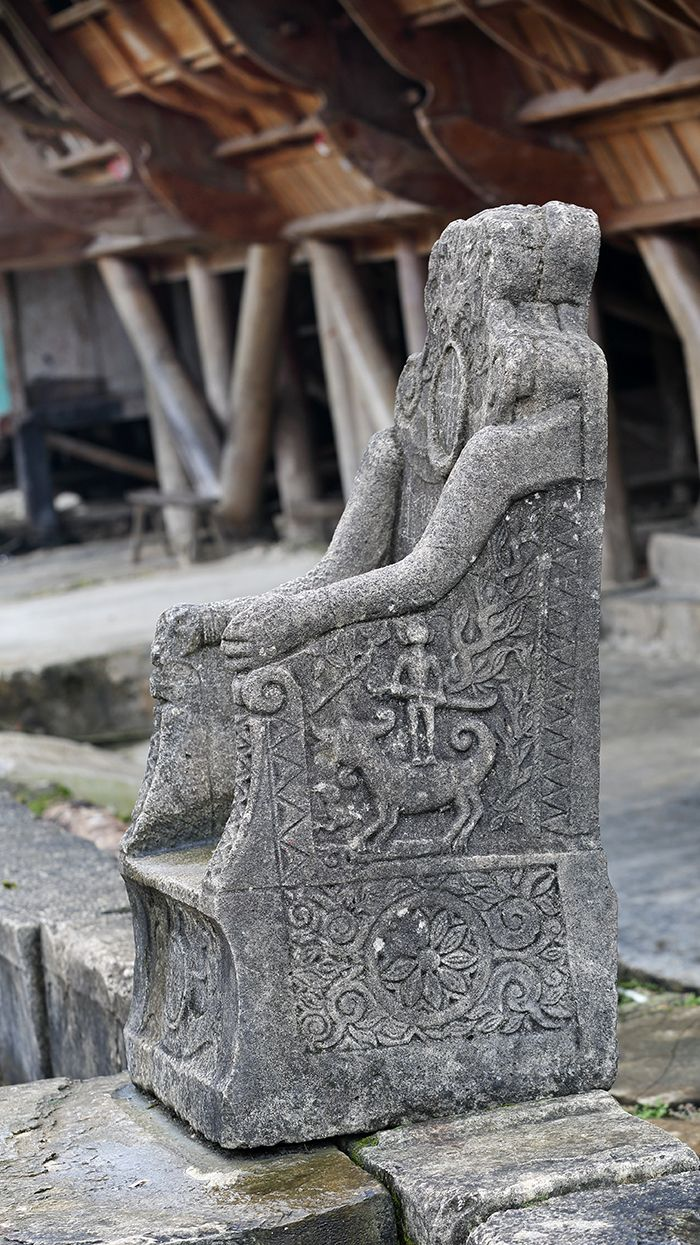 Ornate symbolic carvings one the Chiefs stone chair in Hilimondregeraya village, South Nias. This is one of the villages with best preserved architecture on Nias Island #Indonesia. Photo by Bjorn Svensson. www.visitniasisland.com