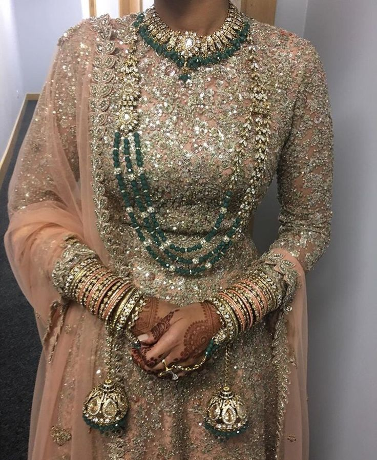 Blush pink bridal lengha + dark green jewelry