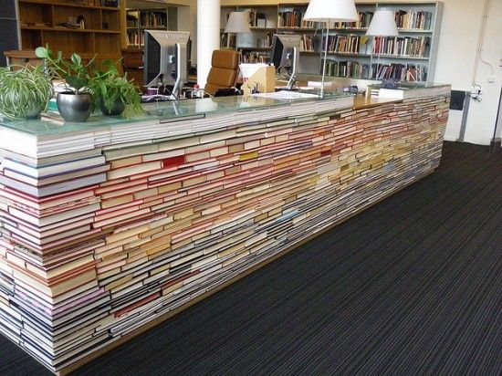 Library reference desk made from books!!  What a great use for weeded books!!!!