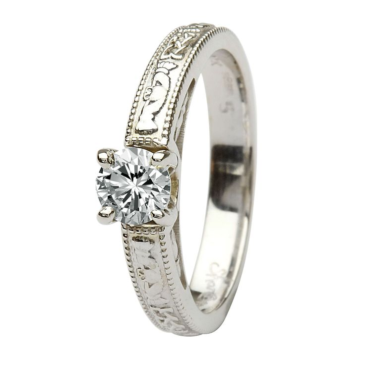 Claddagh engagement ring.... I LOVE THIS! I love that the claddagh symbols are engraved on the band. Just my style!