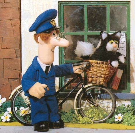 Pictured: The real Postman Pat and his ginger and white cat