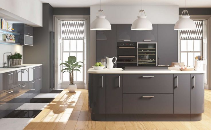 Cut Price Kitchens Euro Grey Gloss Kitchen. Stylish and modern door design. Wrapped in high gloss dark grey pvc. Contrasting white cabinet as standard. Fully matching pvc panels available. Curved units, bifold cupboards and double pan drawers available. Comprising of 18mm thick carcases, soft-close hinges and benefits from 330mm deep wall cabinets. www.cutpricekitchens.co.uk
