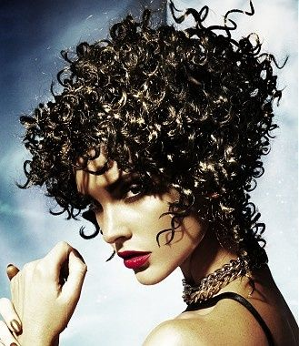 A medium brown curly coloured multi-tonal ringlets medusa perm hairstyle by Joey Scandizzo visit www.ukhairdressers.com