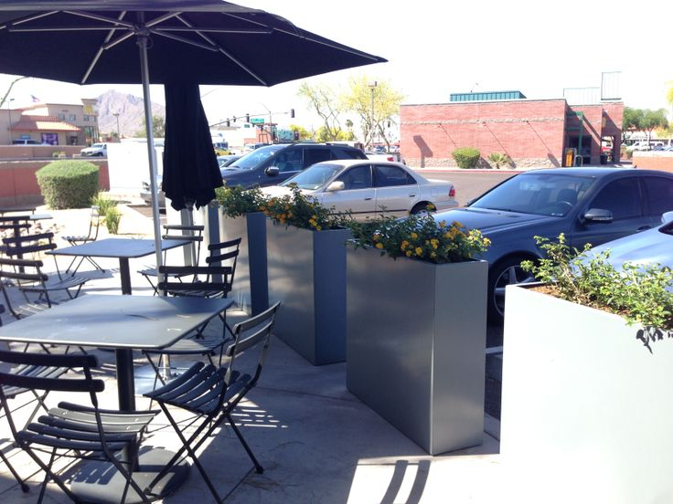 Tall, rectangular, metal planters line the Chipotle patio. Simple lantana plantings. Would love this in a bright color(s) or graphic patterns.