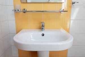 Cheap Bathroom Makeover | Stretcher.com - How to update an outdated bathroom with cheap bathroom makeover ideas