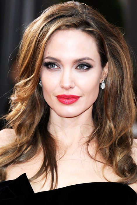 Angelina Jolie: Smokey eyes and classic red lips. I love this look on her.