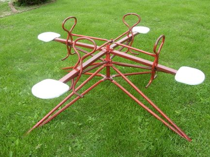 Merry go round, Mitzi and I fished one of these out of the junk pile behind Auntie Kays. Uncle Red got it going for us...it was so much fun!