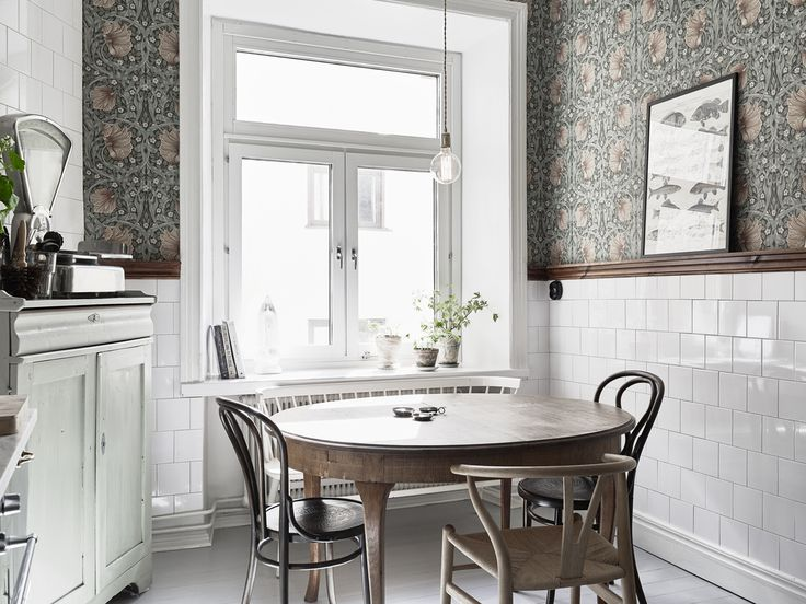 "Scandinavian kitchen: Stainless steel, white tiles, marble, wood and floral wallpaper - ""Tant Johanna"" Linnéstaden, Gothenburg."