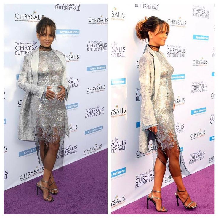 Is 50 year old Halle Berry trying to tell us something? _____ Halle Berry has at the centre of pregnancy rumours after apparently debuting her 'baby bump' on the red carpet last night. _____ The 50-year-old Oscar winner, who has two children already, wore a form-fitting silver sequinned dress and matching heels to last night's Butterfly Ball in Los Angeles, and was pictured posing with her hands over her stomach as if cradling her 'bump'. #OnoBello #OBCelebrities
