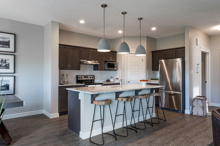 Granite countertops and stainless steel appliances are only a few of the many features this kitchen holds!