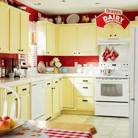 Hot Stuff..Once stuck in neutral, this kitchen gets its kicks from newly painted yellow cabinets and deep red walls distressed with a crackle medium. Hefty black hardware holds its own against the vibrant colors.