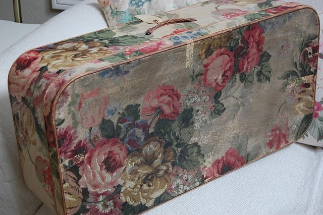 Love this reclaimed suitcase with vintage fabric.