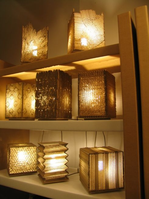 cardboard lampshades created by students at a Foldlife workshope. Foldlife uses only cardboard to craft furniture, lights, art etc.