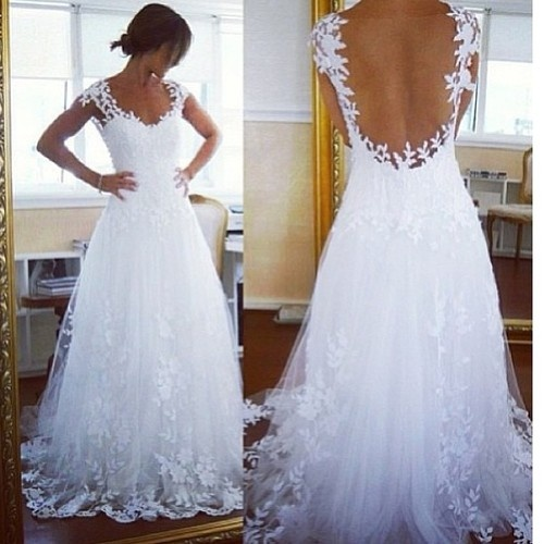 One of the prettiest wedding dresses I've seen out there! Lace appliqués and overlays- very pretty!  Don't get any ideas friends! Just admiring pretty dress!