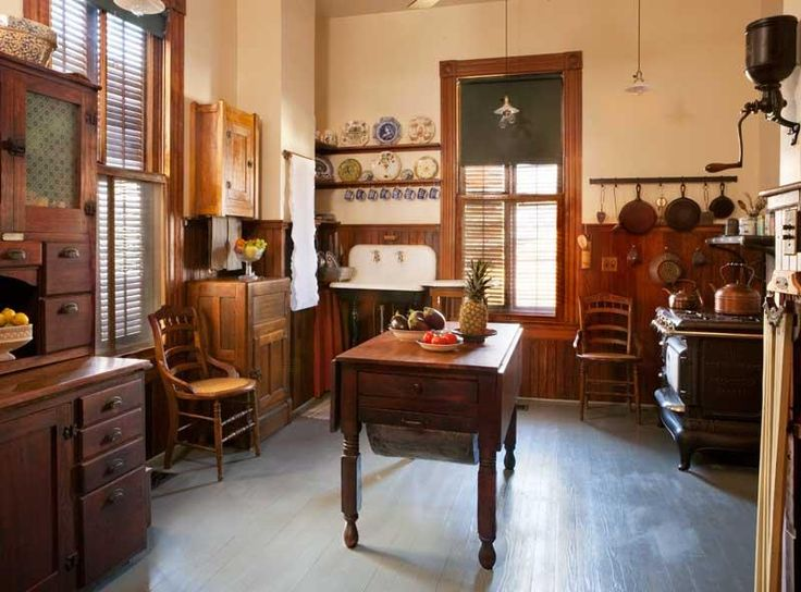 This is how a reproduction Victorian kitchen should look. The combination of Hoosier-style cabinets, storage built into the wainscot, shelves and hooks give the kitchen all the storage of modern fitted cabinets, but without the modern look inappropriate for the Victorian period.