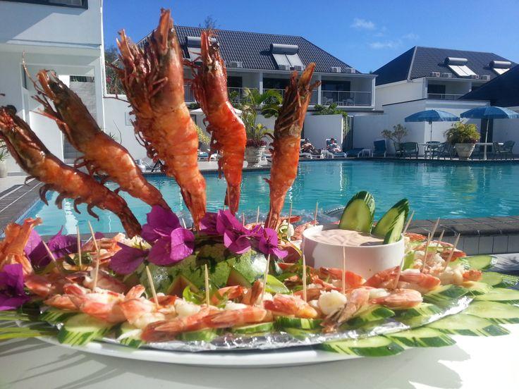 Relax and Indulge poolside at Muri Beach Club Hotel! #pool #prawns #muribeachclubhotel