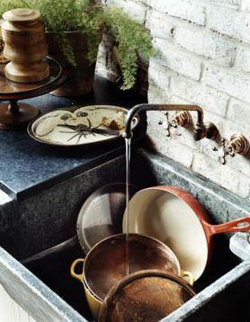 stone sink and countertops + brick backsplash + brass ...