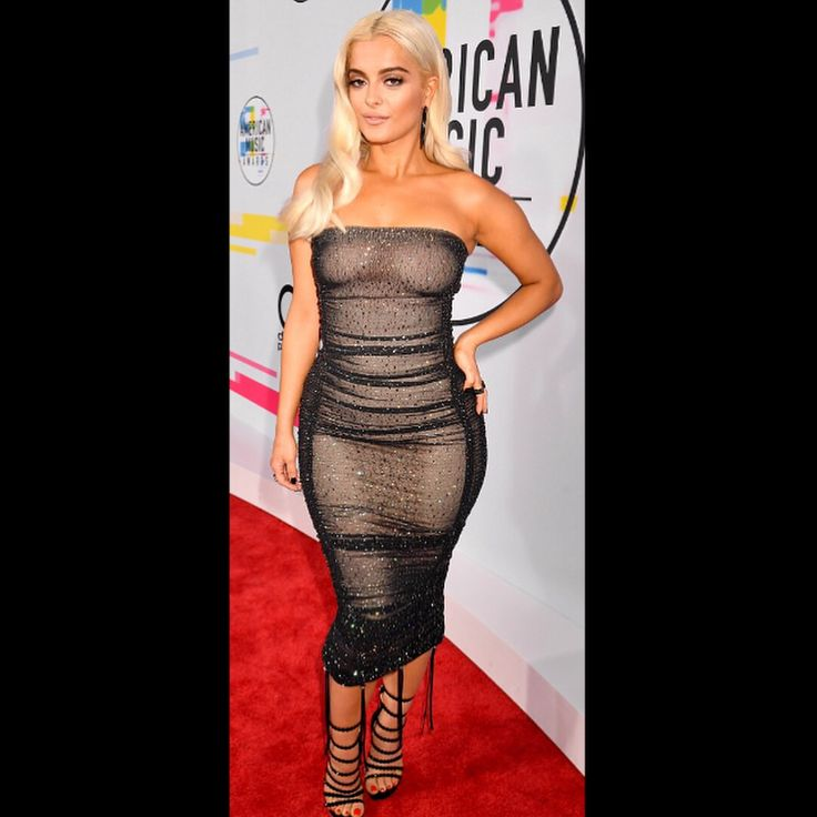 Bebe Rexha flaunting her curves in a August Getty Atelier braless black tube dress  on the red carpet of the 2017 American Music Awards at the Microsoft Theater in Los Angeles. Blond is more fun. . . . .  #BebeRexha #AMAs #AmericanMusicAwards #2hilarious #fashionaddict #celebrityblogger #fashiongram #instafashion #fashionista  #fashionaddict #fashionblogger #fashionstyle #fashionlovers #fashiondiaries #fashionable  #halloweencostume #blond