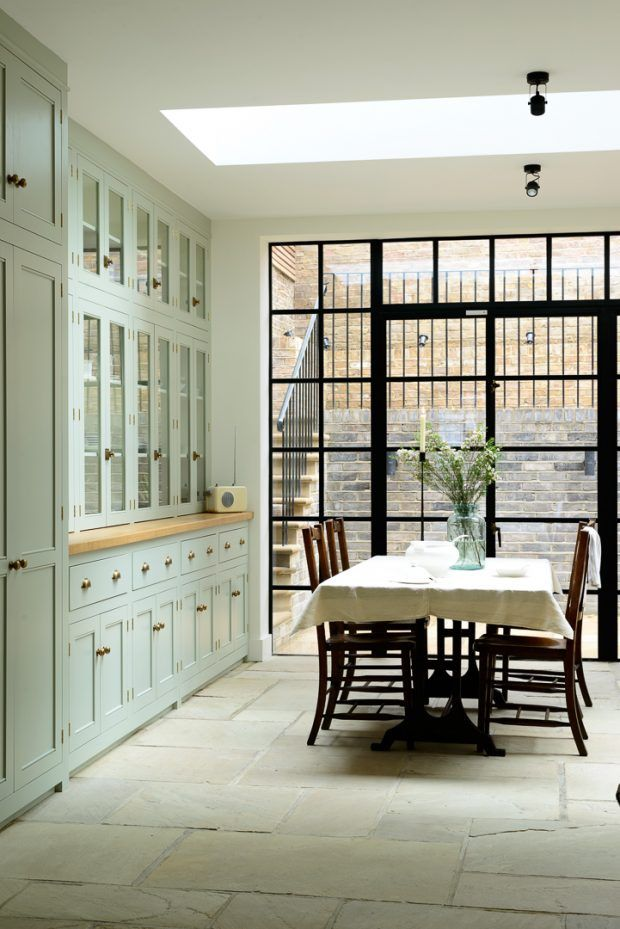 A classic farmhouse kitchen with mint green cabinets, oak countertops, steel windows and doors, an AGA stove, farmhouse sink, and more, via @sarahsarna.