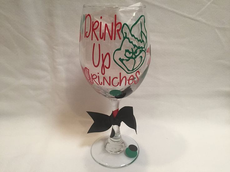 Grinch Wine Glass, Drink Up Grinches, Christmas Wine Glass, Holiday Wine Glass, Drink up Bitches. Drink Up Grinches with a grinch face is on the front of this glass and is then surrounded by red, green and black polka dots. These make great gifts for friends, family, teachers and co-workers or any wine lover. This listing is for 1 glass and it is a 20oz traditional wine glass.