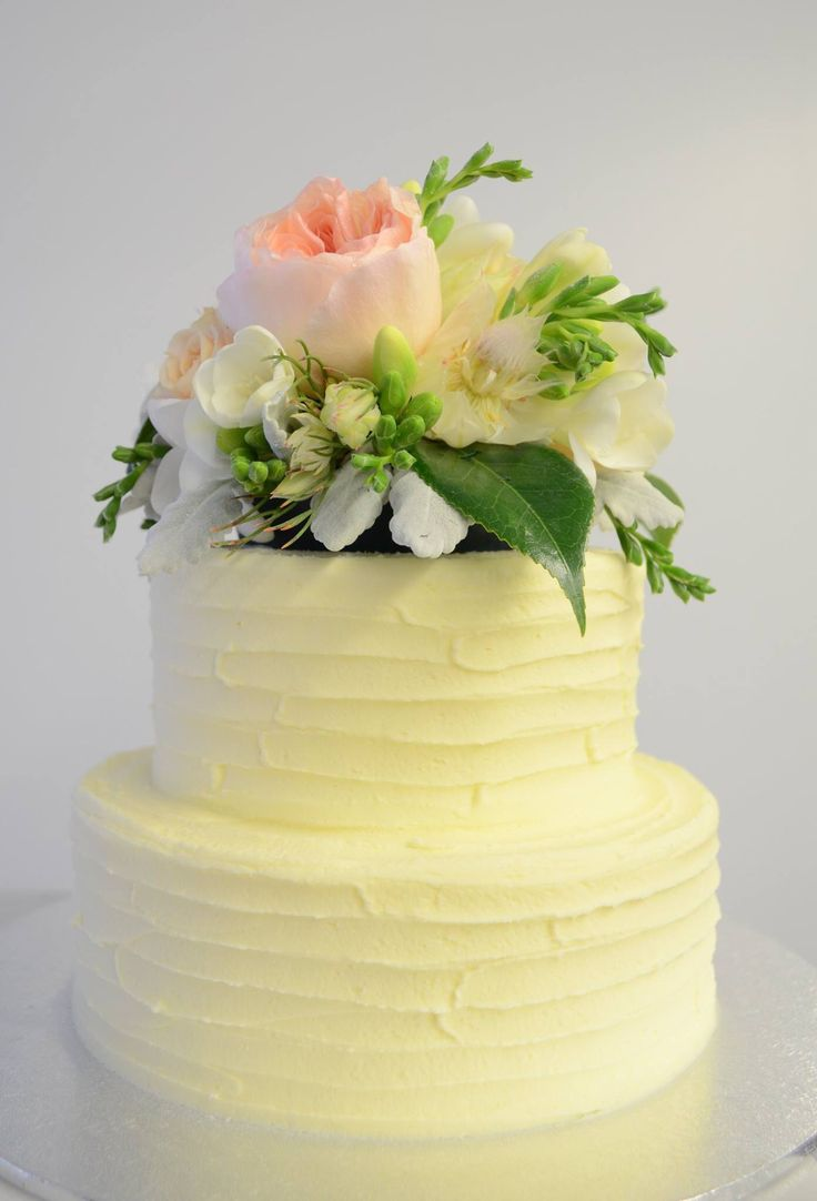 Two tiered cream cheese frosting detailing and flowers
