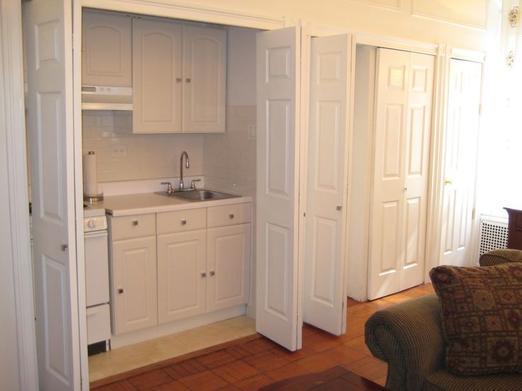 I like the idea of doors not to hide a kitchen but maybe wash machine.