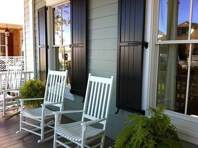 Who doesn't want rocking chairs on their front porch? LOVE the shutters!