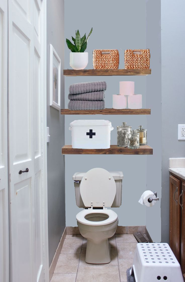 Solving the towel storage dilemma with open shelving above the toilet. Love this…   – most beautiful shelves