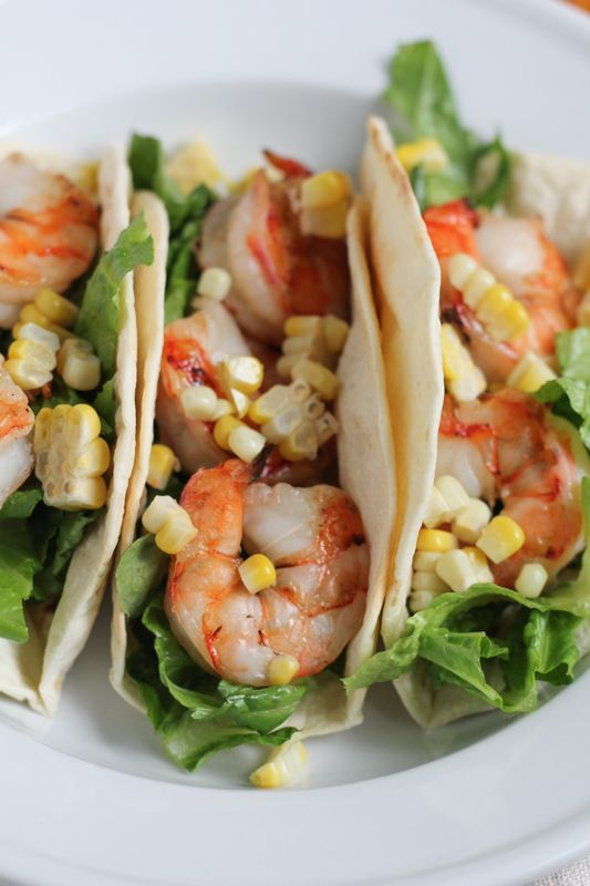 Grilled Shrimp Tacos with grilled corn and a Spicy Mexican Crema sauce. Fresh, insanely flavorful and so easy to make! #tacos #grilling