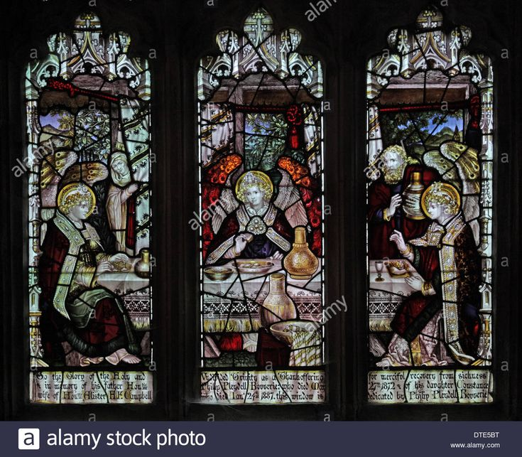 Stained glass window by the Kempe Studios, depicting Abraham entertaining the angels Stock Photo