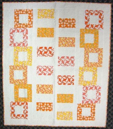 I found Tumbling Blocks Quilt Kit - 'Orange' at Gail Kessler's LadyfingersSewing.com $35.95 includes pattern!