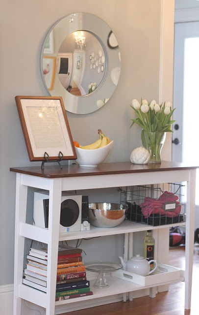 I could use a narrow sideboard table like this in my dining room -- from the kitchen of Modern Jane.