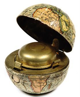 I love antique things, and this little inkwell globe should be mine.
