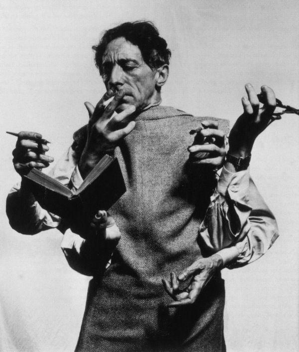 wish I had extra hands!  Jean Cocteau (c) Philippe Halsman 1948.