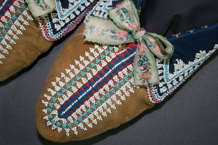 Moccasins made of buckskin, cotton cloth and glass beads ca. 1850.  Conserved at the studio of Spicer Art Conservation. Collection of RMSC