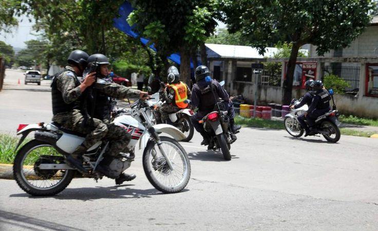 Policías militares en labores de patrullaje. La Policía Militar cumple dos años de servicio a hondureños
