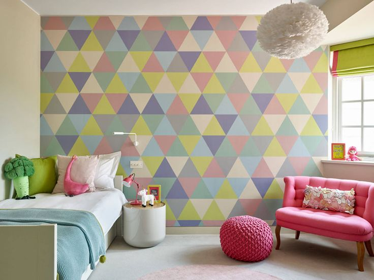 When decorating a cute bedroom for a tween, use fun colors to create a geometric accent wall.
